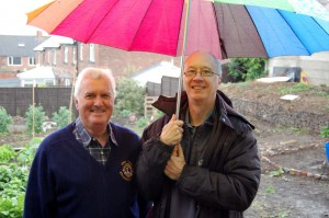 Alan Gilbert from Knaresborough Lions Club and Mark stood beneath an umbrella in our EcoMinds garden